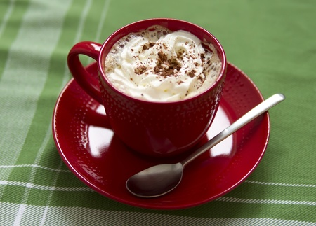 cup of hot coffe with whipped cream