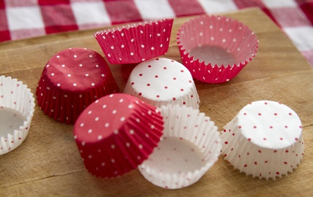 empty cups for cupcakes on kitchen table Stock Photo