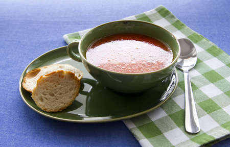 homemade tomato soup in green bowl