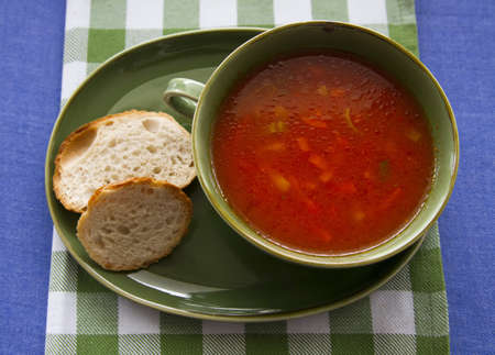 homemade tomato soup served in green bowl