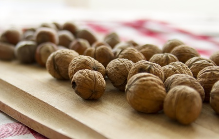 group of walnuts lying on kitchen table