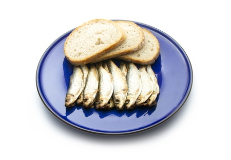 smoked sprats with bread isolated on white background photo