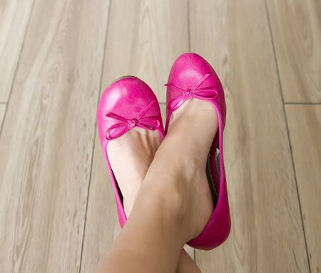 bare female legs in pink balerina shoes Stock Photo - 17727442