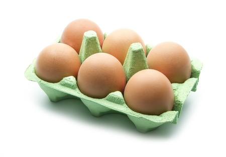 eggs in green box isolated on white background Stock Photo