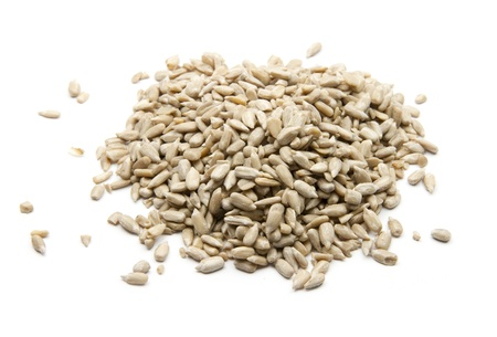 group of sunflower seeds isolated on white background photo