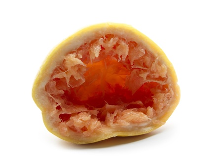 squeezed red grapefruit isolated on white background