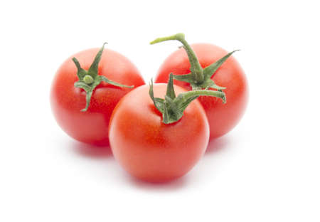 group of cherry tomatos isolated on white background