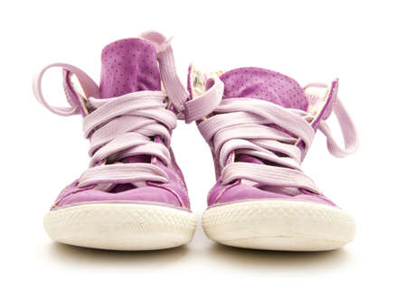 pair of purple sneakers isolated on white background Stock Photo - 18519917