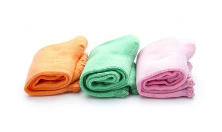 colorful folded socks isolated on white background
