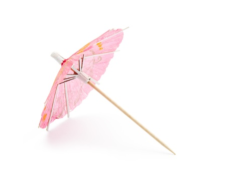 red cocktail umbrella isolated on white background