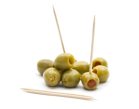 green olives with toothpick isolated on white background Stock Photo