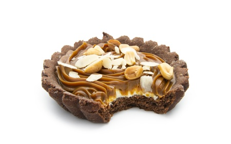 bitten chocolate tart with caramel isolated on white background
