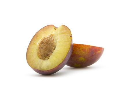 organic plum isolated on white background, cross section Stock Photo