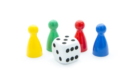 colorful play figures with dice isolated on white background Stock Photo