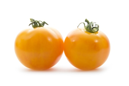 two yellow tomatoes isolated on white background Stock Photo