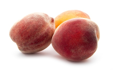ripe organic peach isolated on white background