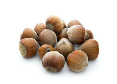 brown hazelnuts isolated on white