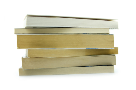 pile of old books isolated on white background photo