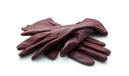 leather gloves: pair of old gloves isolated on white background Stock Photo