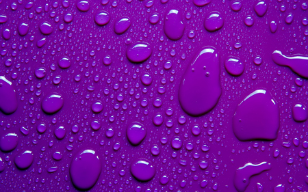 drops of water on purple background Stock Photo