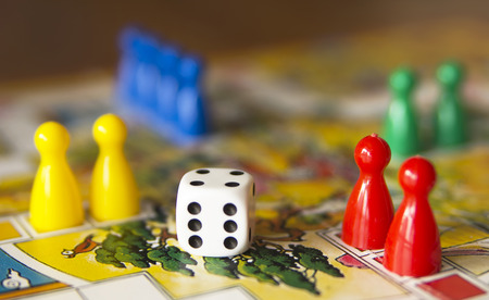 colorful play figures with dice on board