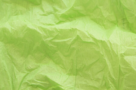 unwrapped: crumpled green crepe paper texture as background
