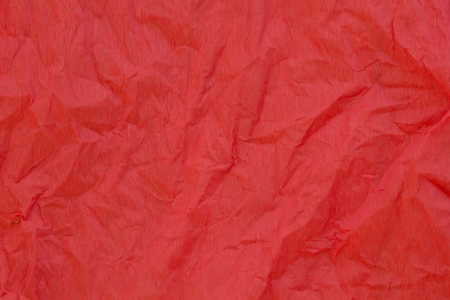 unwrapped: crumpled red crepe paper texture as background