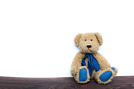 vintage teddy bears: cute teddy bear sitting on wooden board isolated on white background