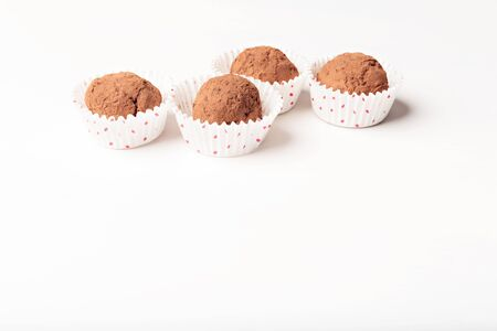homemade chocolate truffles with cocoa powder in paper cups Stock Photo