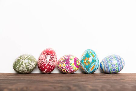 shiny: colorful shiny easter eggs on wooden table