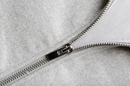 tejido de lana: silver zip on woolen fabric, copy space Foto de archivo