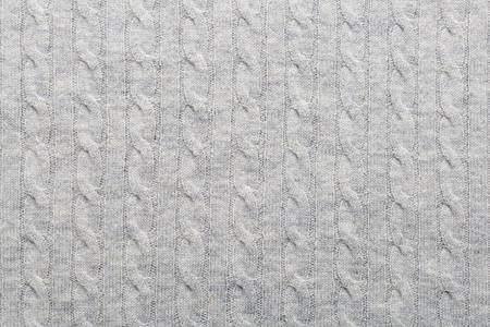 grey woolen knitted fabric as a background