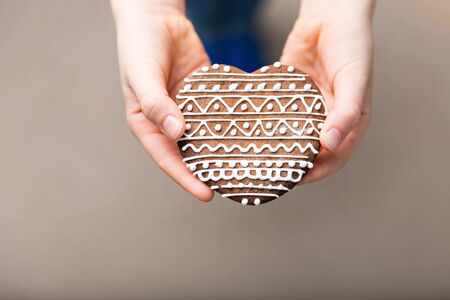gingerbread cookie: gingerbread cookie in hands, copy space Stock Photo