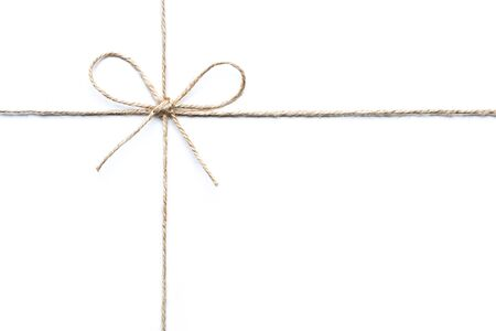 tied in: twine tied in a bow isolated on white background Stock Photo