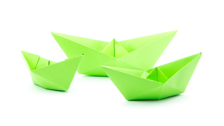 green paper boats isolated on white background Stock Photo