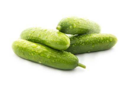 fresh green cucumbers isolated on white background