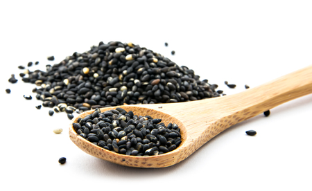 pile of black sesame on wooden spoon Stock Photo