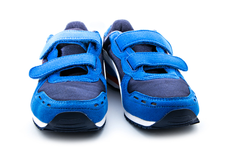 pair of blue sneakers isolated on white background Stock Photo