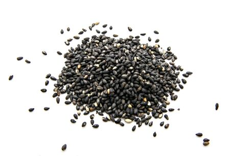 pile of black sesame isolated on white background Stock Photo
