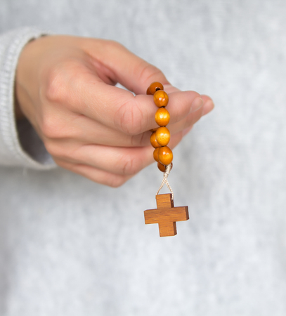 hands with rosary beads, prayer Stock Photo
