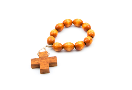 small wooden rosary isolated on white background