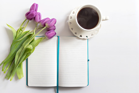 hapy: Flat lay - desk with coffee and flowers