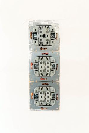 Repairing damaged light switches, installing new Stock Photo
