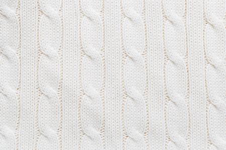 Whiteecru knitted woolen fabric as a background Stock Photo