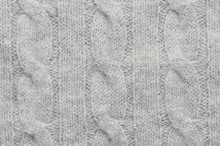 Grey kitted woolen fabric as a background Stock Photo