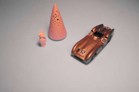 Pink bear, conical tower and nice toy car.