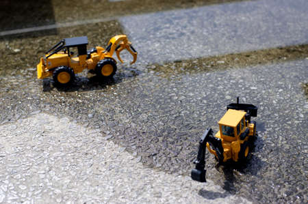 Forklifts and trucks under construction for urban reconstruction. Stock Photo