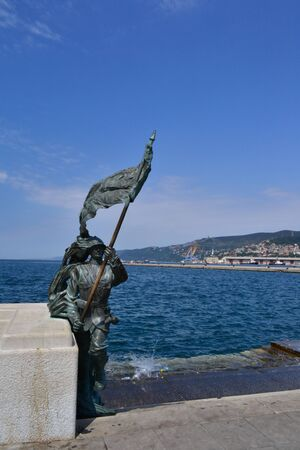 trieste: Trieste, Italy; Bronze of Bersagliere soldier statue with flag in Trieste, near Italian Unification Square.