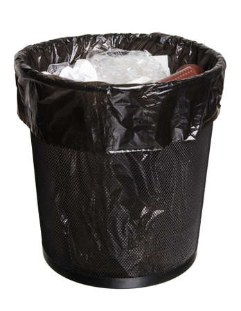 wastebasket: black mesh office bin full of garbage, isolated on white