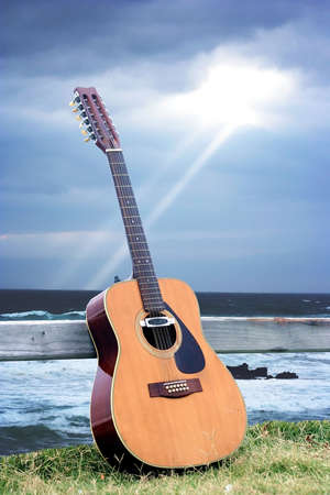 12 String Guitar with ray of light in background Stock Photo